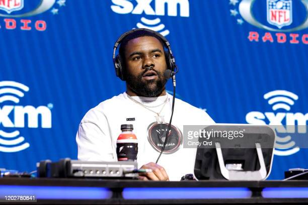 NFL running back Mark Ingram Jr of the Baltimore Ravens speaks onstage during day one with SiriusXM at Super Bowl LIV on January 29 2020 in Miami...