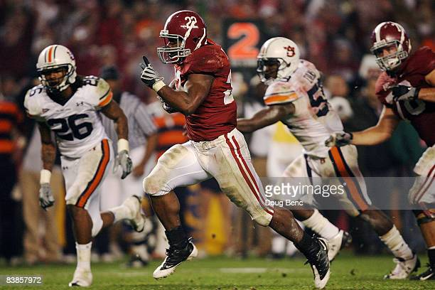 Running back Mark Ingram of the Alabama Crimson Tide breaks away for a touchdown run in the third quarter against the Auburn Tigers at BryantDenny...