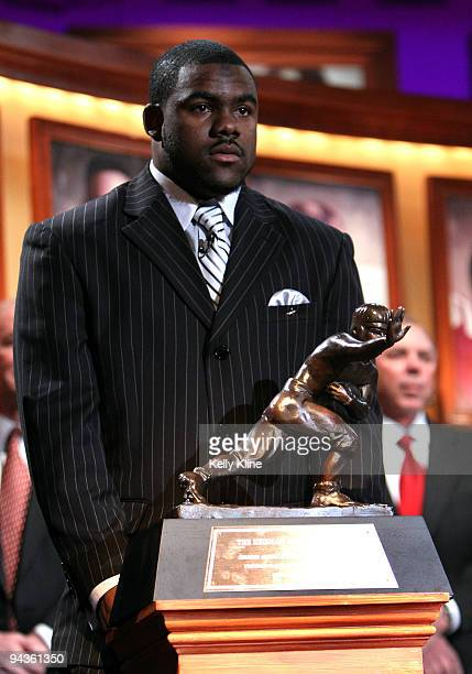 Running back Mark Ingram of the Alabama Crimson Tide poses next to the trophy after being named the 75th Heisman Trophy winner at the Nokia theater...