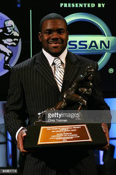 Running back Mark Ingram of the Alabama Crimson Tide poses with the Heisman Trophy during a press conference after being named the 75th Heisman...