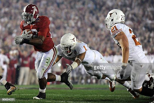 Running back Mark Ingram of the Alabama Crimson Tide runs with the ball as Keenan Robinson of the Texas Longhorns tries to tackle during the Citi BCS...