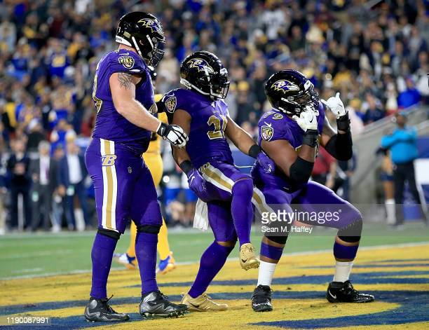Running back Mark Ingram of the Baltimore Ravens and teammates celebrate his touchdown against the Los Angeles Rams during the third quarter of the...