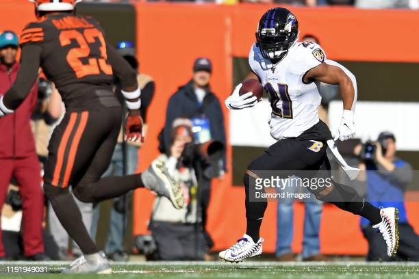 Running back Mark Ingram of the Baltimore Ravens carries the ball in the first quarter of a game against the Cleveland Browns on December 22, 2019 at...