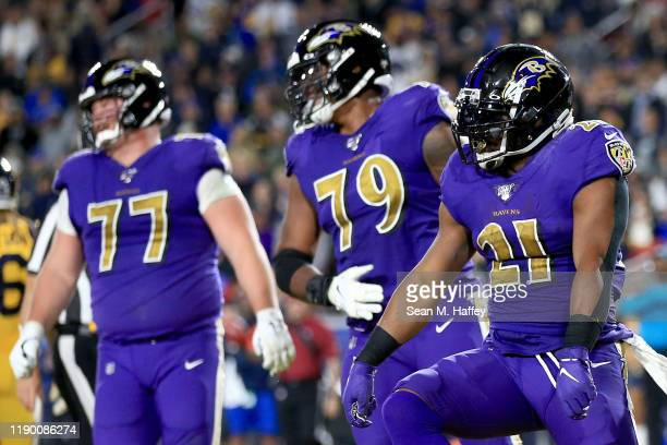 Running back Mark Ingram of the Baltimore Ravens celebrates his touchdown in the third quarter of the game against the Los Angeles Rams at Los...