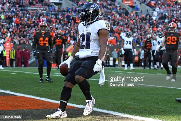 Running back Mark Ingram of the Baltimore Ravens scores a 12-yard receiving touchdown in the third quarter of a game against the Cleveland Browns on...
