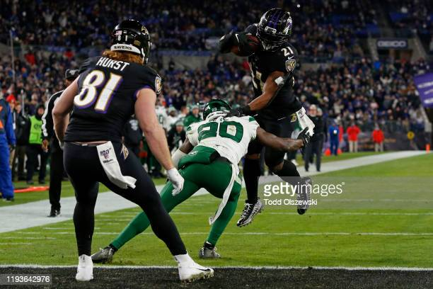 Running back Mark Ingram of the Baltimore Ravens scores a touchdown during the fourth quarter against the New York Jets at MT Bank Stadium on...