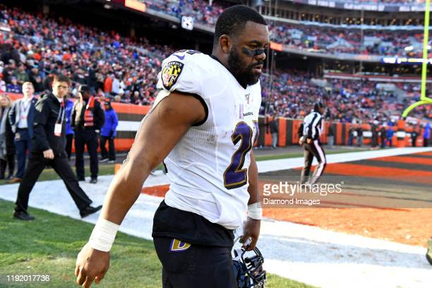 Running back Mark Ingram of the Baltimore Ravens walks onto the field at halftime of a game against the Cleveland Browns on December 22, 2019 at...