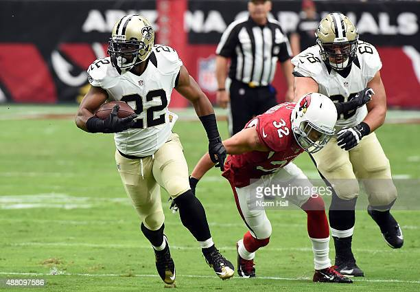 Running back Mark Ingram of the New Orleans Saints breaks past safety Tyrann Mathieu of the Arizona Cardinals during the first quarter of the NFL...