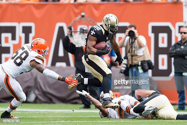 Running back Mark Ingram of the New Orleans Saints caries the ball as he avoids a tackle from outside linebacker Christian Kirksey of the Cleveland...