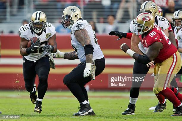 Running back Mark Ingram of the New Orleans Saints carries the ball for a 14yard gain against the San Francisco 49ers in the fourth quarter on...