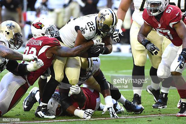 Running back Mark Ingram of the New Orleans Saints carries the football against Arizona Cardinals defense in the first quarter at University of...