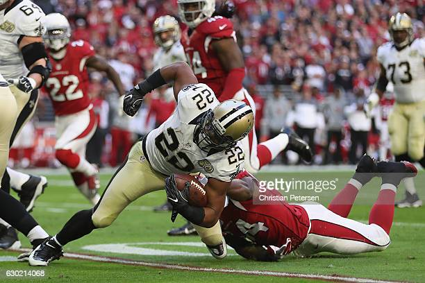 Running back Mark Ingram of the New Orleans Saints carries the football against inside linebacker Sio Moore of the Arizona Cardinals in the first...