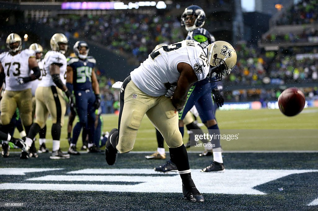 Running back Mark Ingram #22 of the New Orleans Saints celebrates after scoring on a two-point conversion in the fourth quarter against the Seattle Seahawks during the NFC Divisional Playoff Game at CenturyLink Field on January 11, 2014 in Seattle, Washington.