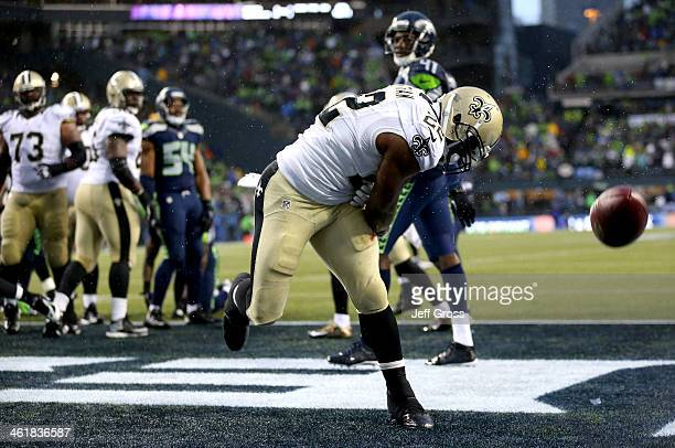 Running back Mark Ingram of the New Orleans Saints celebrates after scoring on a two-point conversion in the fourth quarter against the Seattle...