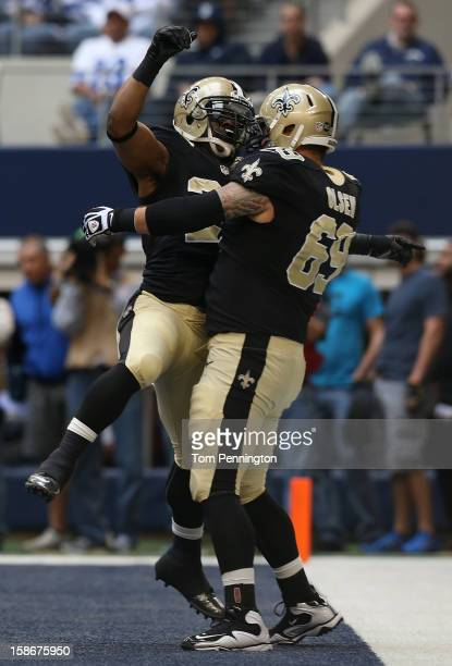 Running back Mark Ingram of the New Orleans Saints celebrates with guard Eric Olsen of the New Orleans Saints after scoring against the Dallas...