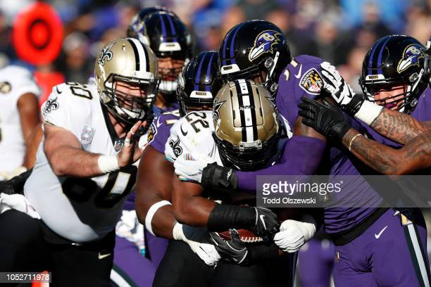 Running back Mark Ingram of the New Orleans Saints is tackled as he carries the ball by linebacker CJ Mosley of the Baltimore Ravens in the first...