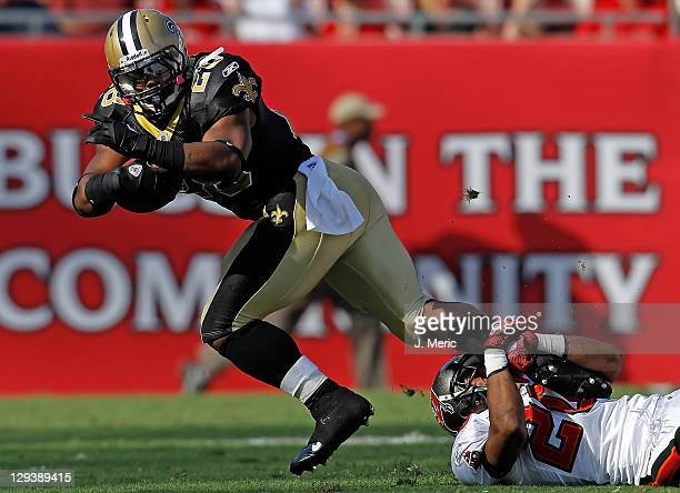 Running back Mark Ingram of the New Orleans Saints is tackled by defender Ronde Barber of the Tampa Bay Buccaneers during the game at Raymond James...