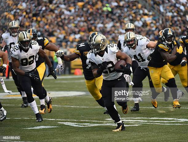 Running back Mark Ingram of the New Orleans Saints runs with the football as he is pursued by linebackers Lawrence Timmons and Sean Spence of the...