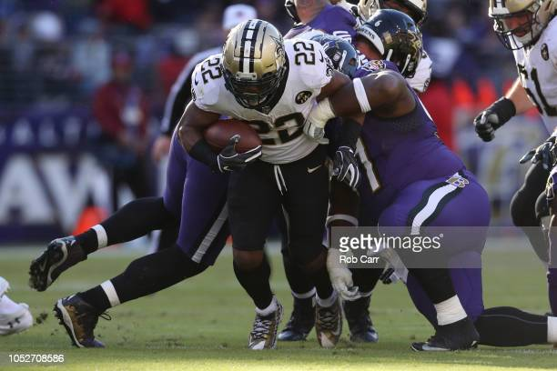 Running Back Mark Ingram of the New Orleans Saints runs with the ball in the first quarter against the Baltimore Ravens at MT Bank Stadium on October...