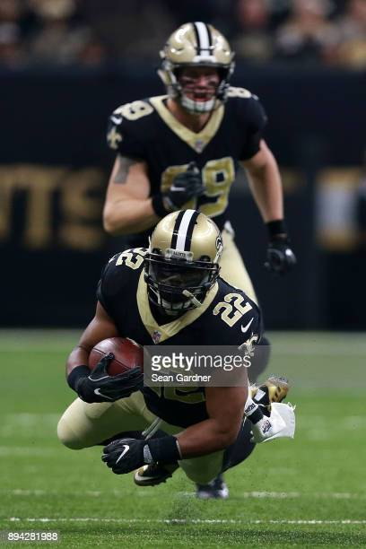 Running back Mark Ingram of the New Orleans Saints runs with the ball during the first half of a game against the New York Jets at the MercedesBenz...