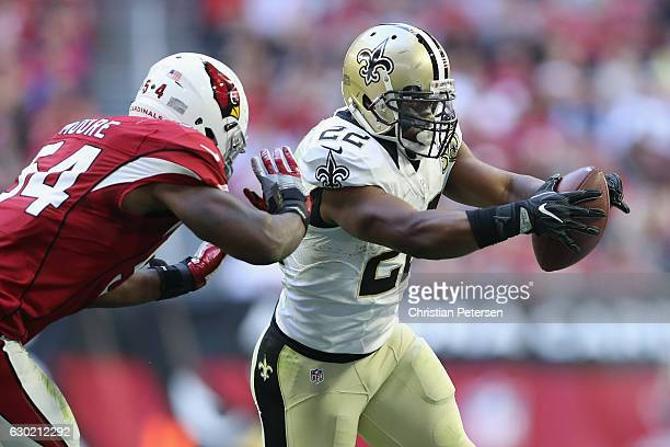Running back Mark Ingram of the New Orleans Saints runs with the football in front of inside linebacker Sio Moore of the Arizona Cardinals in the...