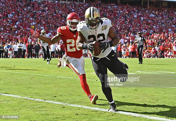 Running back Mark Ingram of the New Orleans Saints rushes in for a touchdown against defensive back Steven Nelson of the Kansas City Chiefs during...