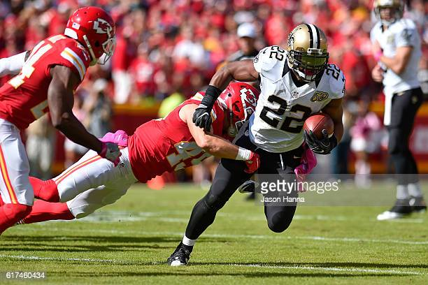 Running back Mark Ingram of the New Orleans Saints rushes the ball while being tackled by defensive back Daniel Sorensen of the Kansas City Chiefs at...