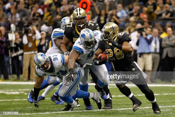 Running back Mark Ingram of the New Orleans Saints rushes with the ball against the Detroit Lions at MercedesBenz Superdome on December 4 2011 in New...