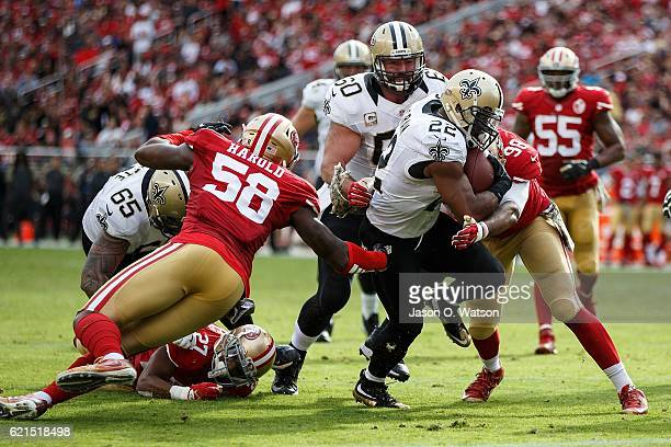 Running back Mark Ingram of the New Orleans Saints scores a touchdown against the San Francisco 49ers during the second quarter at Levi's Stadium on...