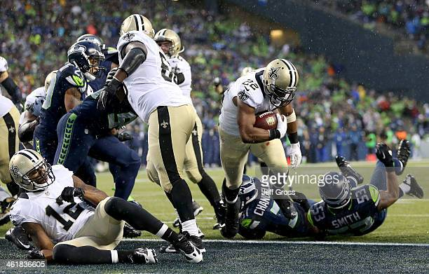 Running back Mark Ingram of the New Orleans Saints scores on a twopoint conversion in the fourth quarter against the Seattle Seahawks during the NFC...