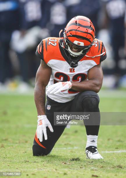 Running back Mark Walton of the Cincinnati Bengals reacts to an injury from a kickoff return in the second quarter against the Los Angeles Chargers...