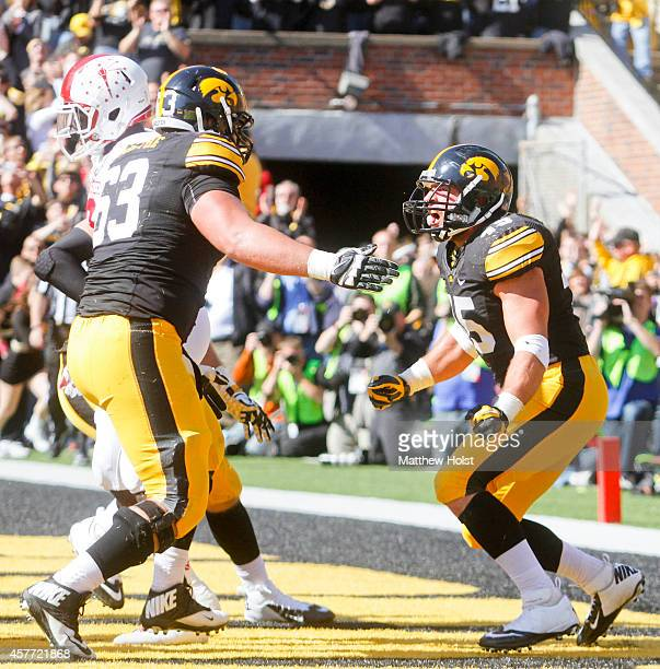 Running back Mark Weisman celebrates with offensive lineman Austin Blythe of the Iowa Hawkeyes after scoring a touchdown in the second quarter...