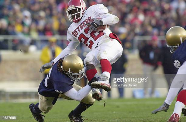 Running back Markis Facyson of Rutgers is tripped up by cornerback Preston Jackson of Notre Dame in the second half of their game on November 23,...