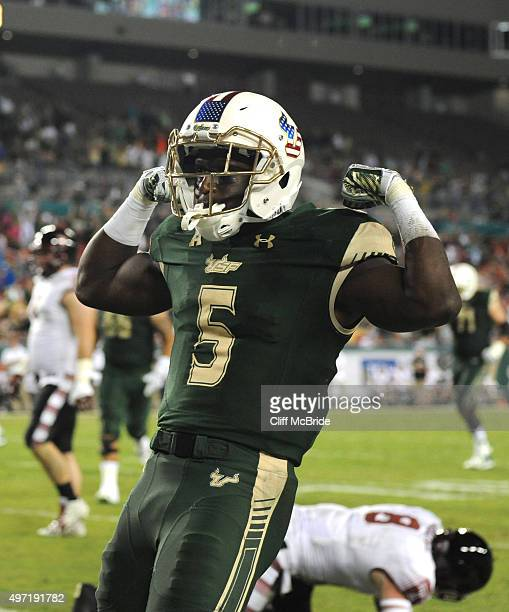 Running back Marlon Mack of the South Florida Bulls celebrates after scoring a touchdown in the second quarter against the Temple Owls at Raymond...