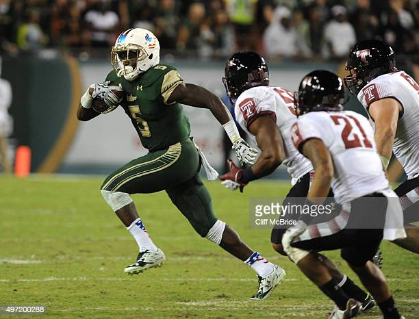 Running back Marlon Mack of the South Florida Bulls runs with the ball in the third quarter against the Temple Owls at Raymond James Stadium on...