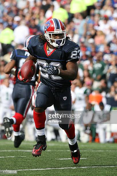 Running Back Marshawn Lynch of the Buffalo Bills runs the ball against the New York Jets during the NFL game at Ralph Wilson Stadium, Orchard Park,...