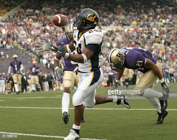 Running back Marshawn Lynch of the California Golden Bears hauls in a touchdown pass against Derrick Johnson and Dashon Goldson of the Washington...