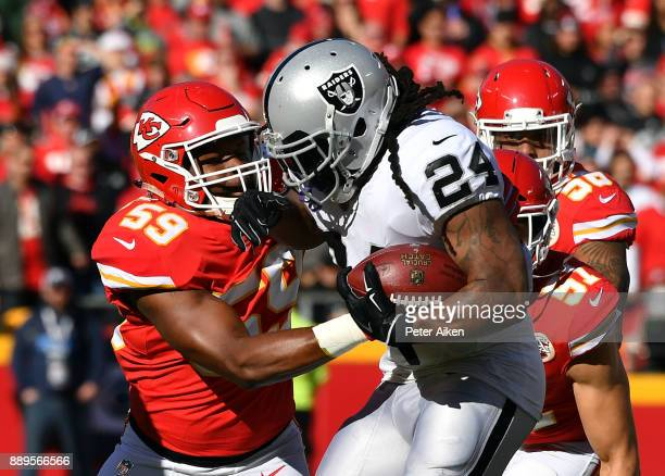 Running back Marshawn Lynch of the Oakland Raiders carries the ball as inside linebacker Reggie Ragland of the Kansas City Chiefs defends during the...