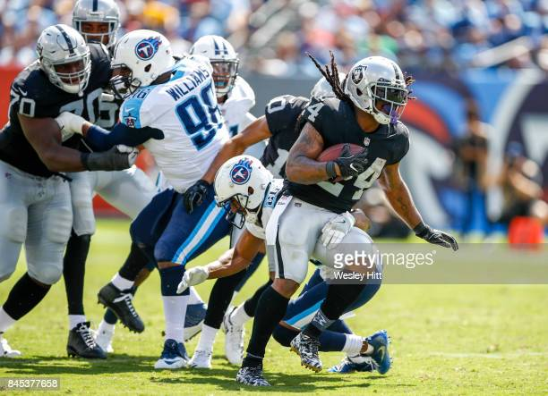 Running back Marshawn Lynch of the Oakland Raiders runs the ball against the Tennessee Titans in the second half at Nissan Stadium on September 10...