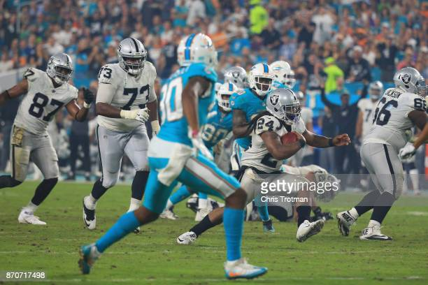 Running back Marshawn Lynch of the Oakland Raiders runs with the ball against the Miami Dolphins at Hard Rock Stadium on November 5 2017 in Miami...