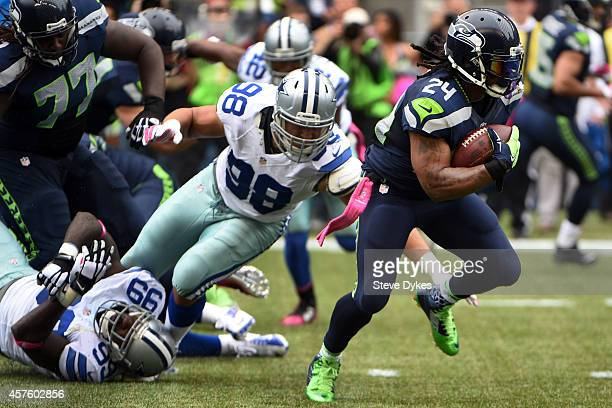 Running back Marshawn Lynch of the Seattle Seahawks avoids the tackle of defensive end Tyrone Crawford of the Dallas Cowboys during the third quarter...