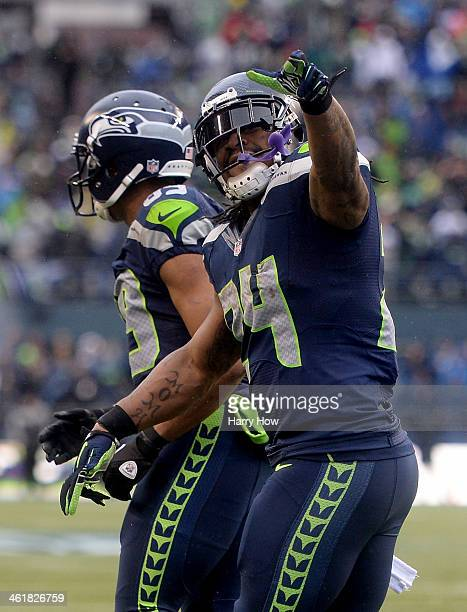 Running back Marshawn Lynch of the Seattle Seahawks celebrates after Lynch scores on a 15-yard run in the second quarter against the New Orleans...