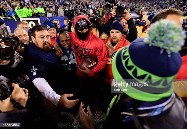 Running back Marshawn Lynch of the Seattle Seahawks celebrates with his mother Delisa Lynch after their 438 victory over the Denver Broncos during...