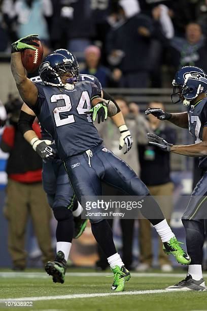 Running back Marshawn Lynch of the Seattle Seahawks jumps across the goalline as he runs for a 67-yard touchdown run in the fourth quarter against...