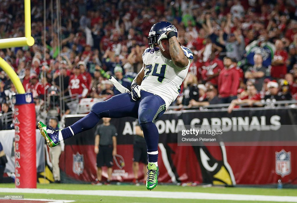 Running back Marshawn Lynch #24 of the Seattle Seahawks leaps to score a 79 yard touchdown in the fourth quarter during the NFL game against the Arizona Cardinals at the University of Phoenix Stadium on December 21, 2014 in Glendale, Arizona.