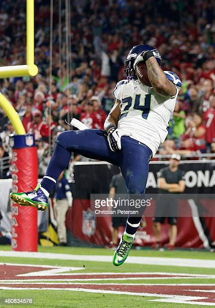 Running back Marshawn Lynch of the Seattle Seahawks leaps to score a 79 yard touchdown in the fourth quarter during the NFL game against the Arizona...