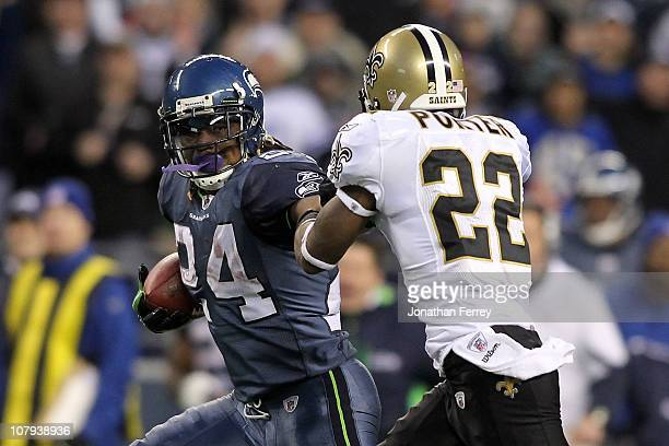 Running back Marshawn Lynch of the Seattle Seahawks runs for a 67yard touchdown run in the fourth quarter against Tracy Porter of the New Orleans...