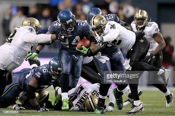 Running back Marshawn Lynch of the Seattle Seahawks runs for a 67yard touchdown run in the fourth quarter against the New Orleans Saints during the...