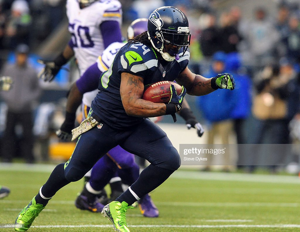Running back Marshawn Lynch #24 of the Seattle Seahawks runs for a touchdown during the fourth quarter of the game against the Minnesota Vikings at CenturyLink Field on November 17, 2013 in Seattle,Wa. The Seahawks won the game 41-20.