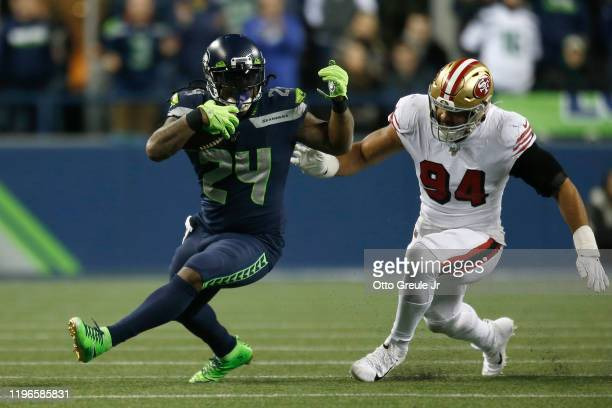 Running back Marshawn Lynch of the Seattle Seahawks runs the ball against defensive end Solomon Thomas of the San Francisco 49ers during the game at...